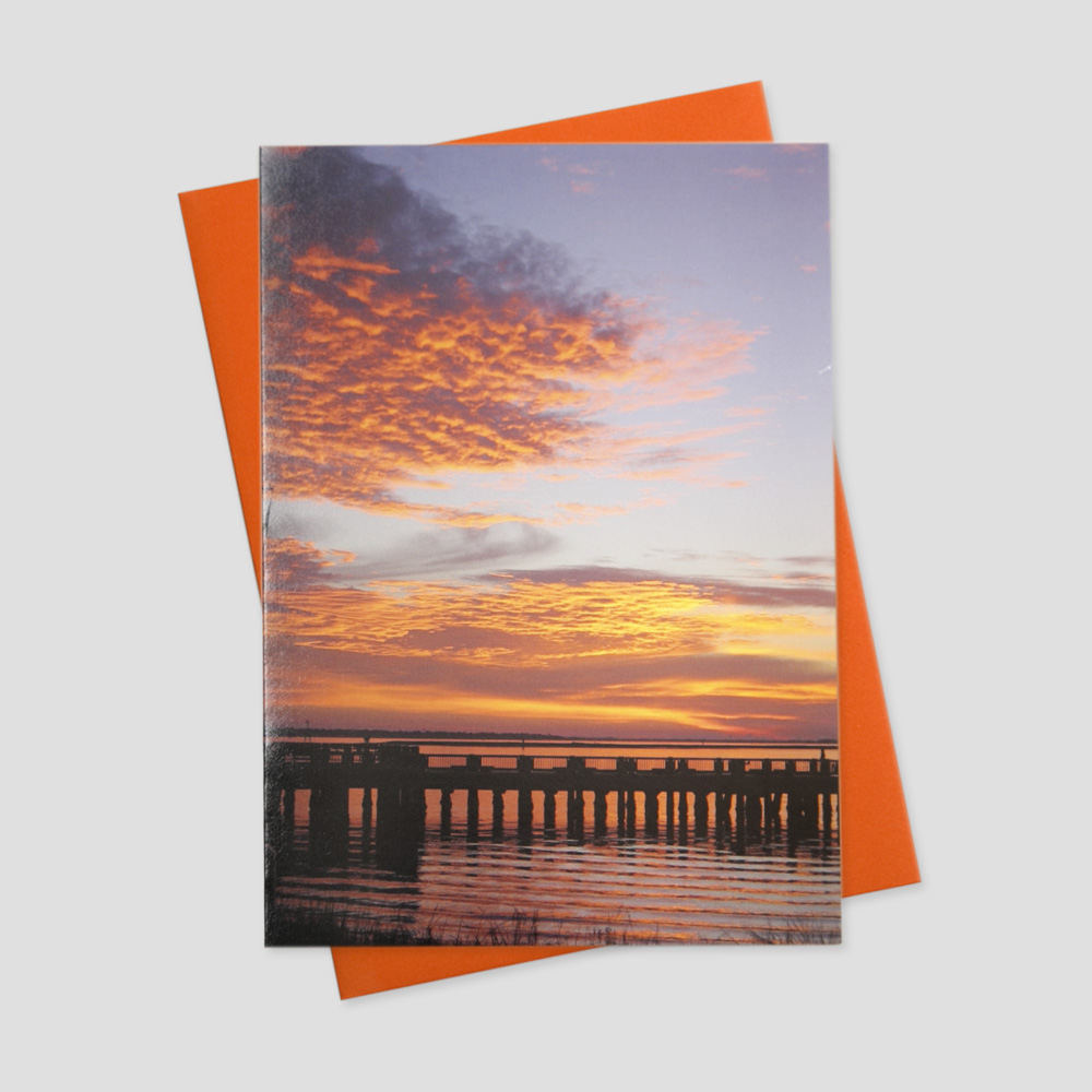 Summertime greeting card featuring an image of a long wooden pier on the sound side of a beach