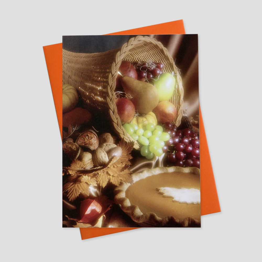 Corporate Thanksgiving greeting card featuring a cornucopia filled with harvest treats and a pumpkin pie