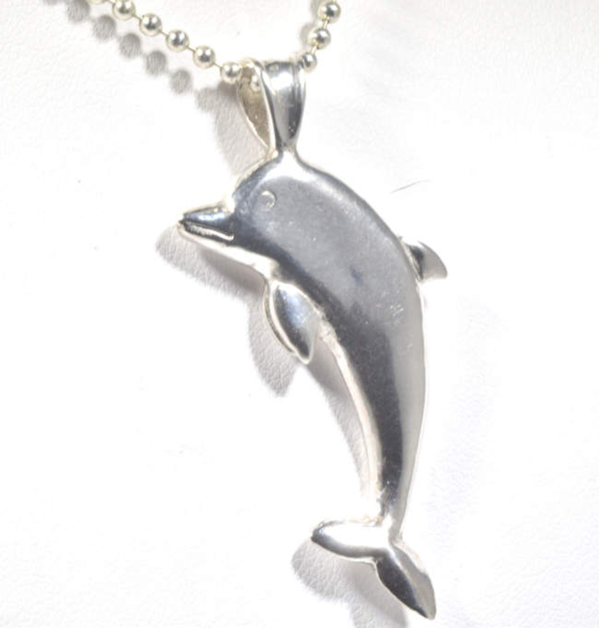 Dolphin silver pendant the sterling silver dolphin pendant is hand crafted in portland maine the dolphin is aloadofball Image collections