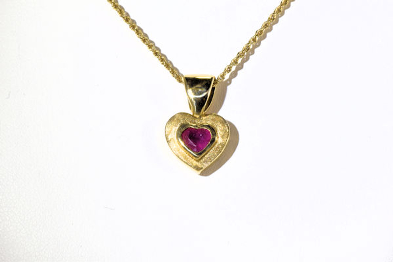 Ruby heart gold pendant the gold hear ruby pendant is hand crafted in portland maine the ruby is aloadofball Gallery