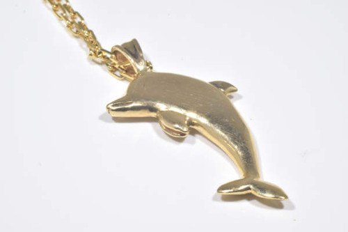 Gold dolphin pendant the 14 k yellow gold dolphin pendant is hand crafted in portland maine aloadofball Gallery