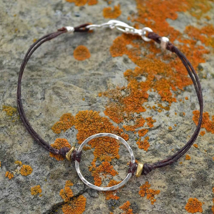 Handmade sterling silver circle bracelet with waxed linen cord