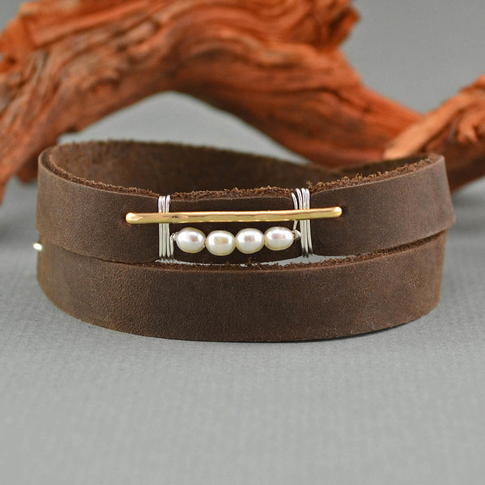 Handmade leather cuff bracelet with four luminous pearls wrapped with 14kt gold filled wire: view 1