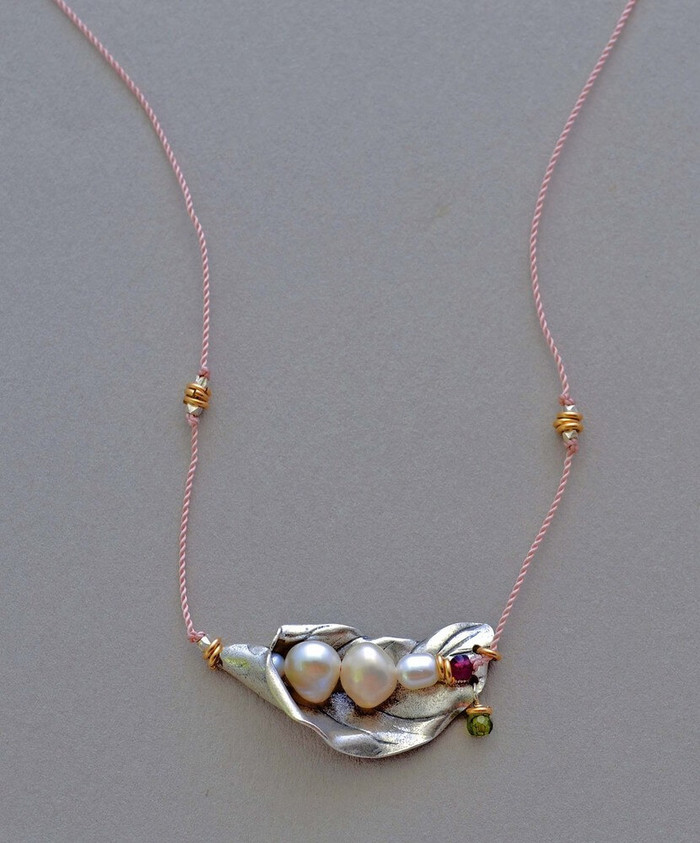 Handmade necklaces with four pearls, garnet stones and sterling silver petal