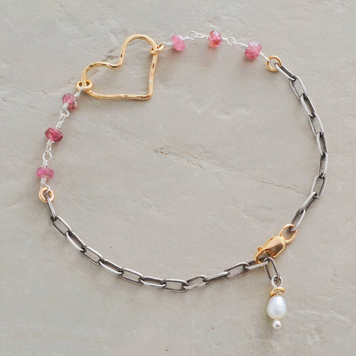 Handmade charm bracelets with pink tourmaline and gold filled sterling silver in heart shape