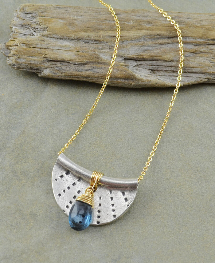 Handcrafted necklaces with stamped sterling silver and a blue topaz gemstone: view 1