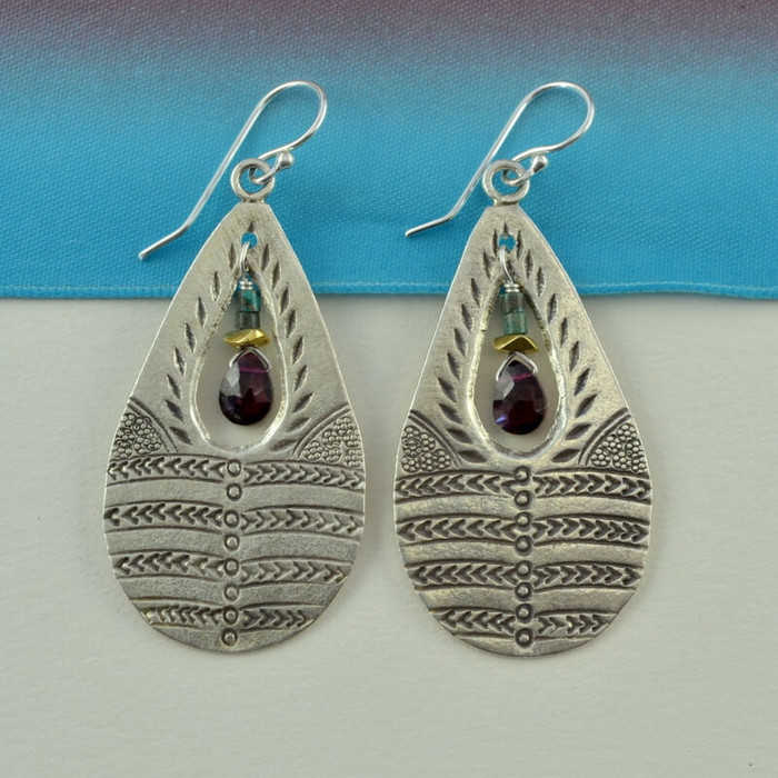 handmade earrings made with stamped sterling silver and gemstones