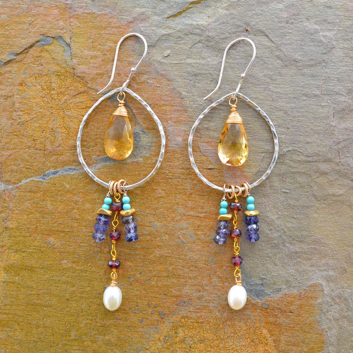 Handcrafted earrings with different types of vibrant gemstones in teardrop shape