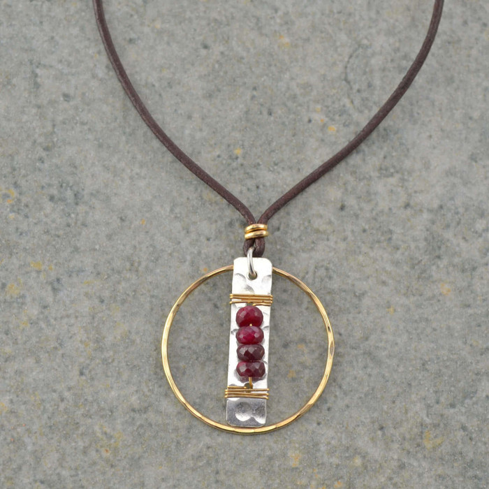 handmade leather necklace with four garnet stones wrapped to a sterling silver: view 1
