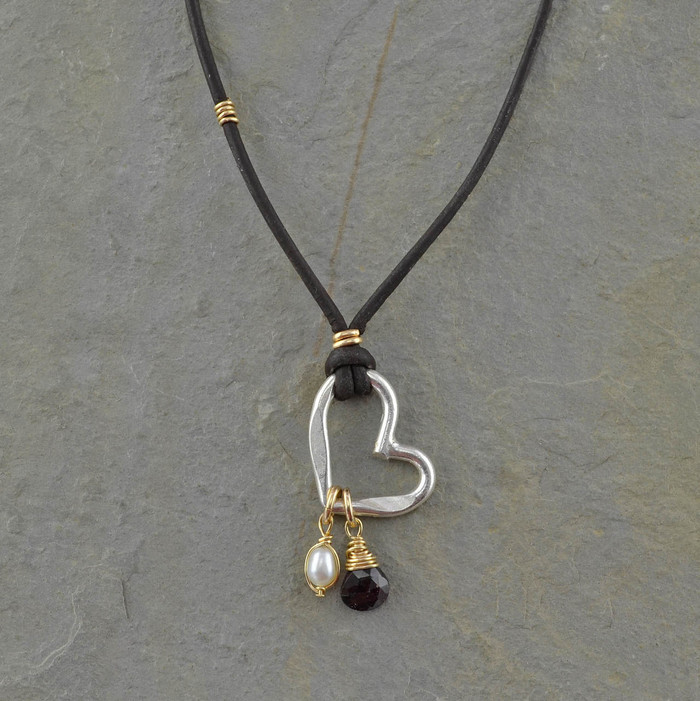 handcrafted brown leather necklace with freshwater pearl, a sterling silver heart pendent, and a garnet stone: view 1