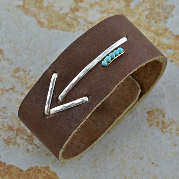 handmade leather bracelet features with a sterling silver arrow and five vibrant turquoise seed beads