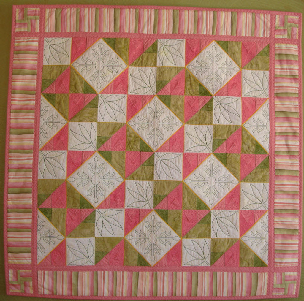 Mother & Child! A block from the 2012 Mystery Quilt repeats to make this beautiful quilt.