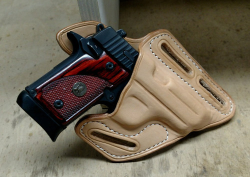 3-Slot Pancake Holster. Wear strong side or cross draw. Shown in un-dyed leather, but available in many colors.