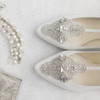 Annalise Art Deco wedding shoes Inspired by the glamour of the Great Gatsby era Hand-embroidered with baguette crystals, glass and string beads in a signature Art Deco pattern Comfortable 2.5 inch kitten heel and T-strap for a vintage transformation Hand-embroidered and made to order Exclusive design from Bella Belle Bridal shoe collection White.  Ivory: we can dye this shoe ivory for an additional cost.  See details below on dyeing. 100% dyeable silk Genuine Leather Lining Dye them to rewear them after your special day Sizing runs true to size Please note due to this being a custom made item with handmade embellishment, this item can only be exchanged to another size. Dyeing Ivory Option:  We can dye this shoe ivory for additional cost of $29.  You can purchase our dyeing service by adding this service (click here for link) to your cart and completing the purchase of the shoes and dyeing service alltogether.  Dyeing takes approximately additional 7-10 days.  All dyed shoes are final sale.