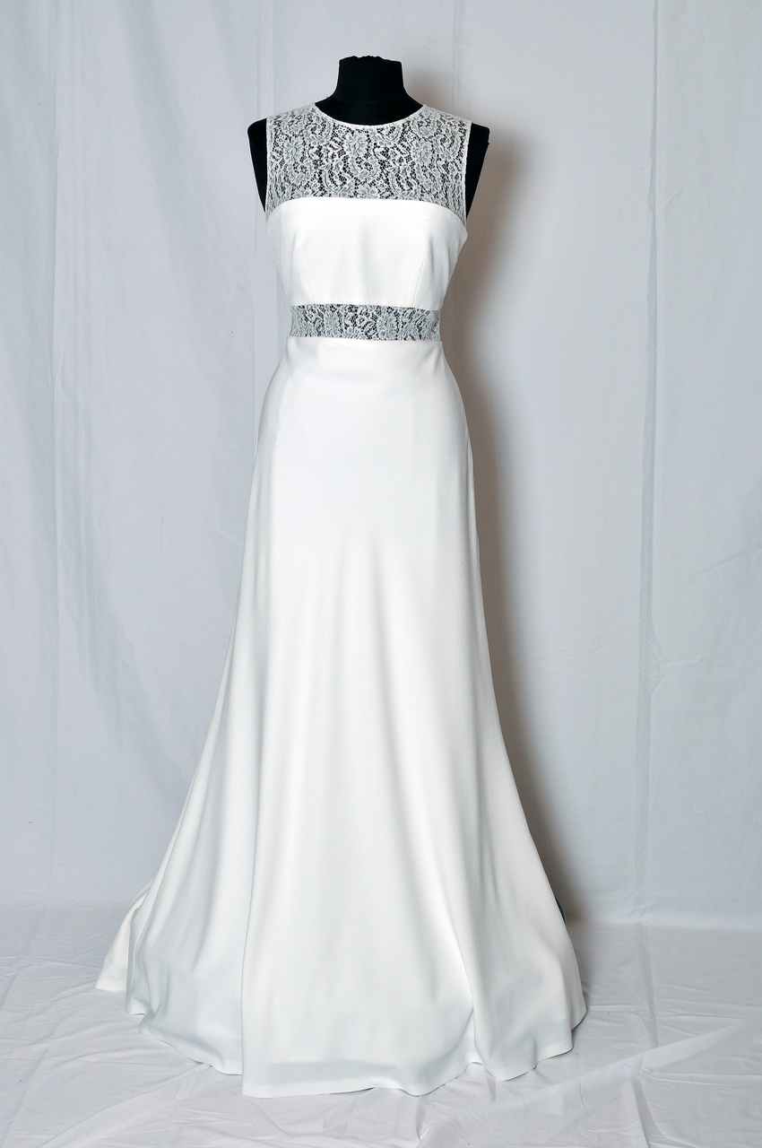 Strong-lined wedding dress with a panelled design of Chantilly lace and crepe.
