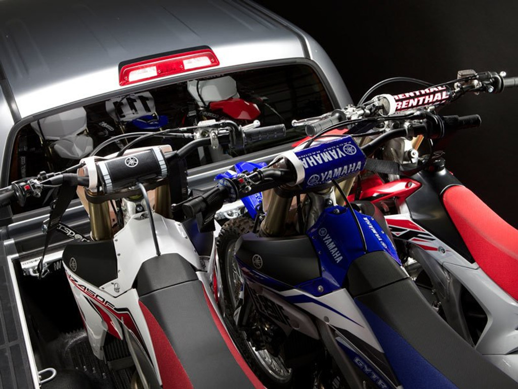 The 3rd Bike Extender for the Nissan Utili-track makes transporting three motorcycles easy by staggering the middle bikes, making room for the handlebars.