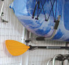 Kayak wall rack with built in paddle holder