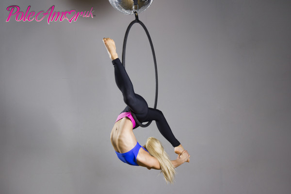 Hoop, aerial ring or Lyras are standard props we have seen in the circus arena for many years. Now becoming popular in pole studio's as the next progression   Our one point hoop is made from special thick wall mild steel tube. This is then costed in an epoxy powder coating baked in a a oven for a longer lasting coating, thus allowing you to re-tape your hoop again and again without the 'paint' finish flaking off like other low quality hoops on the market.  Due to the changes with insurance companies in this ever expanding market, we have taken no risk and our hoop has been certified 'SAFE' by an independent testing agent to give you piece of mind that our equipment is fully certified for your safety and is now certified for 2 people.  The hanger is ready to accept any suitable carabiner in order to attach it to a strop, hanging cable etc.   If you want to make you Hoop rotate you can also add a high strength swivel (LINK HERE) at the top of your assembly.  If you would like you hoop another colour Please email us HERE  SAFETY NOTE:  Make sure that all requirement is maintained correctly use a logging system and coding on equipment. Check all equipment regularly and replace as required.  ManufacturerPolesiks Ltd Country of ManufactureUK Tubing diameter33.7mm /Steel ColourBlack Working Load Limit 360kg / 793 lbs (Safe for 2 people)
