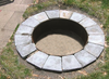 Steel Fire Pit Insert:  A shown in the ground with surrounding fire pit pavers.