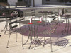 """Homecrest Wynn Steel Outdoor Dining Bistro Set: As shown Wynn Armless Cafe Chair's and the Steel Mesh 30"""" Round Cafe Table in a powder coated Storm finish."""