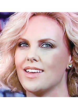 Charlize Theron wearing the Lisa Freede Small Solid Pyramid Stud Earrings