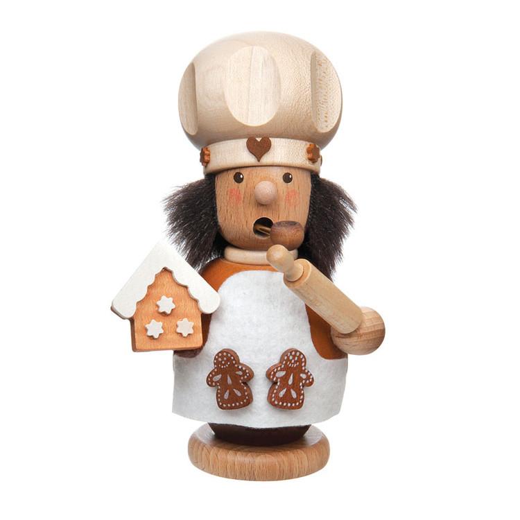 Baker Making Gingerbread Houses