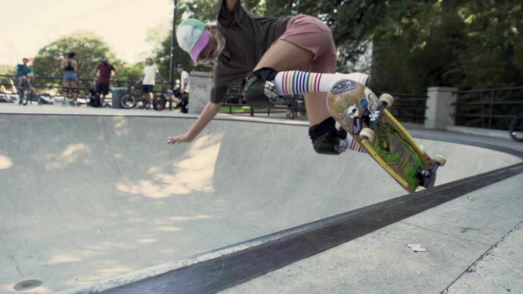showing off skater boarder skills in white compression pride socks