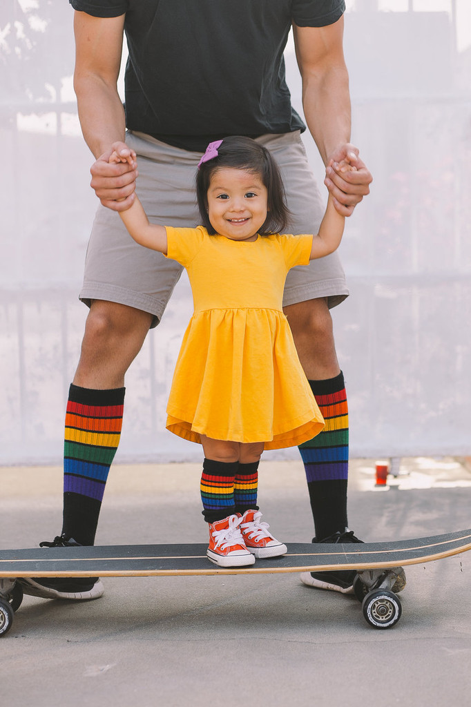 daddys girls wearing pride socks