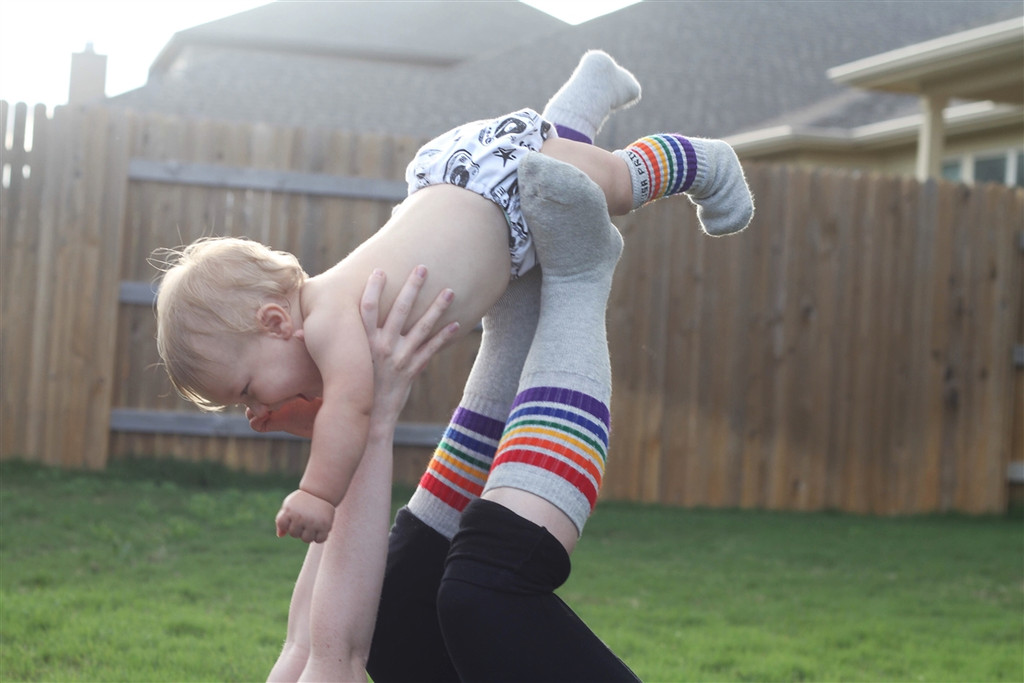 i love having fun with my mom when we wear our love pride socks and play