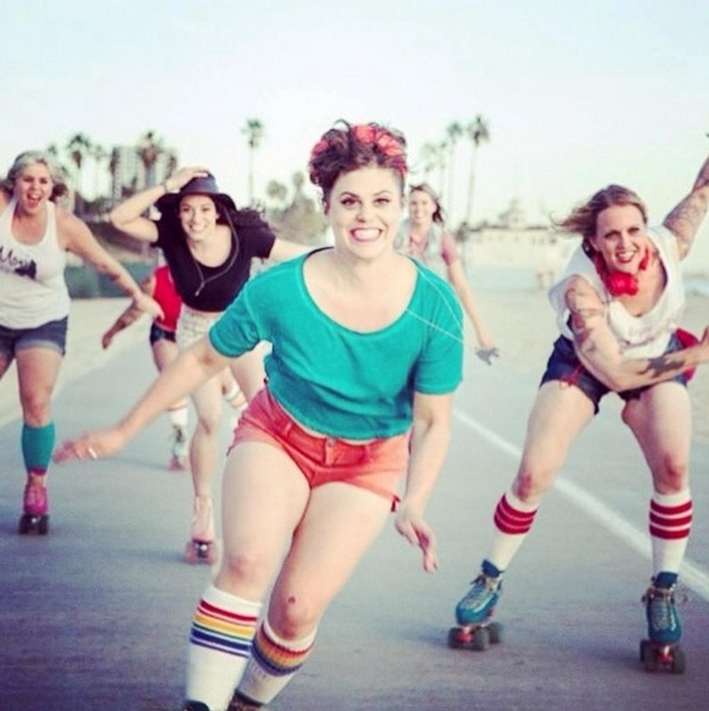 moxie skate crew skating in their pride socks