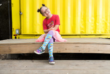 ruby of rubys rainbow showing off her dream big pride socks that help those with Down syndrome to attend college.