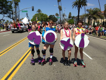 the moxi skate team are rock stars wearing the pride socks in the LA Pride