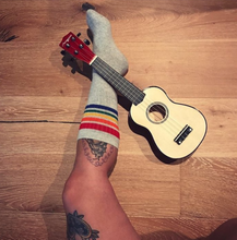 i am proud to be able to rock out the guitar and my vintage pride socks