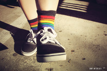 put each foot in front of the other as you show off your pride socks and where they are taking you on this adventure you call life