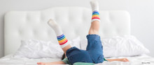 toddlers just wanna have fun in their rainbow striped pride socks