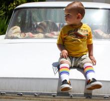 sitting here in my rainbow toddler tube socks watching the neighbors!