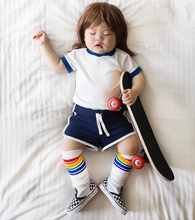 i fell asleep wearing my toddler rainbow striped tube socks  while protecting my skate board.
