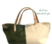 The JACKIE is lightweight and stylish bag for any season with a relaxed attitude. Softest leather combined with beautiful fabric. Natural cowhide accents. Fully lined and the perfect pocket for your cell phone.  Leather handles and roomy.  JACKIE can be carried on the arm or the shoulder.  It's a pleasure to carry.