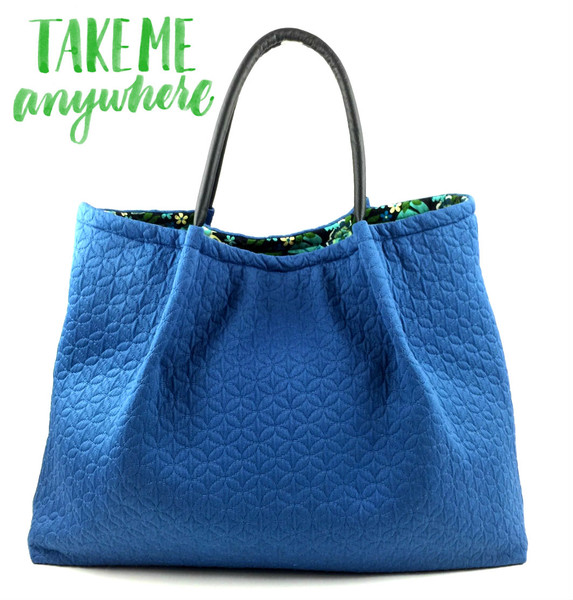 This Matelasse Blue Lola tote bag is perfect for all day carry. Attractive and flexible, this designer tote offers a fresh take on designer bags