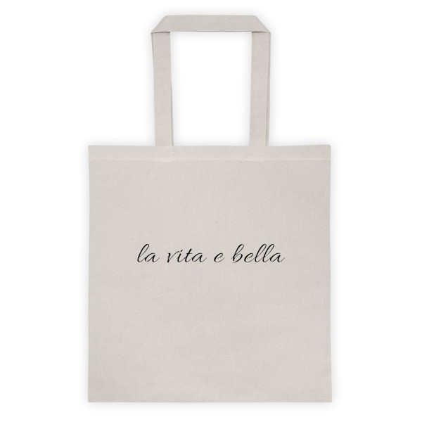 """This cotton canvas tote bag is both stylish and practical.  • 6 oz, 100% cotton canvas  • 22"""" dual handles  • Dimensions: 14 ½"""" x 15 ½""""   DESIGN by FILIPPA I PIUGGI"""