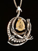Curled Dragon Pendant with Rutilated Quartz