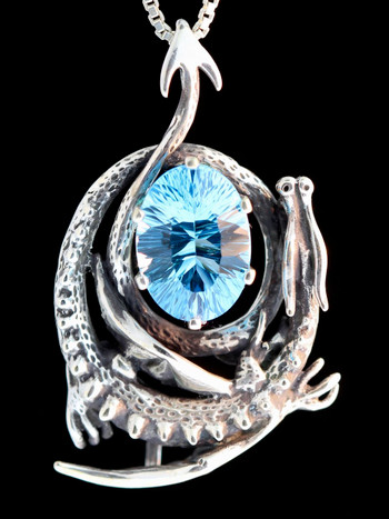 Curled Dragon Pendant with fancy cut blue topaz