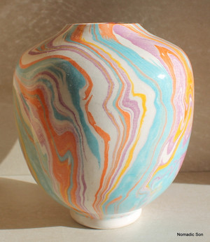 This incredible vase is a completely unique one off vase made by Elagoz (the only artist in the world to master Ebru on ceramics).  Sublime swirling patterns; a blend between the artist and the uncontrollable nature of Marbling.
