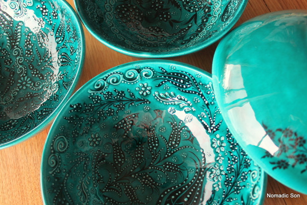 20cm handmade and hand painted ceramic bowls.  In a deep jade green with black intricate details.
