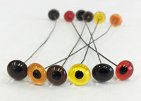 Medium Grade Glass Eyes shown from left in Medium Brown, Straw, Hazel, Yellow, Dark Brown & Red.