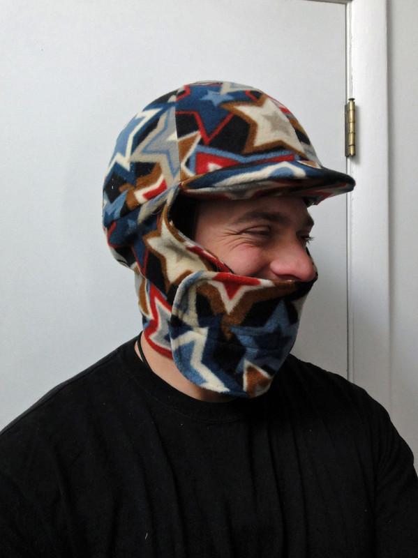 Bob, the ever patient husband modeling his helmet cozy. He is wearing the cover in the down position keeping his face and neck warm. Helmet is a large Troxel.