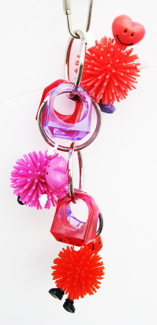 1728 Hold my heart bird toy, a sweet heart of a deal for your small to medium-sized feathered friends.
