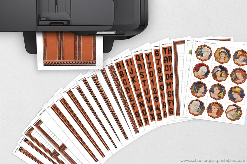 Ancient Greece kit page coming out of a printer, all pages shown on table
