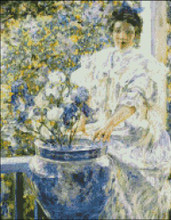 Woman on Porch with Flowers