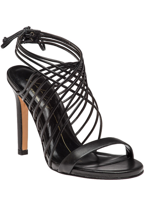 """This fabulous evening sandal by Lola Cruz features a crisscross  strappy  vamp and a unique tie closure. Dazzle under the moonlight in this stunning evening sandal.  Black leather upperLeather linedCushioned footbedLeather soleCrisscross vampRear tieApprox. 4.25"""" heel"""
